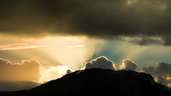The Sun arrives (Tommy Høyland) Tags: rays sun blue cloudscape dark sunrise light mountain nature nobody horizen orange clouds outdoor