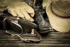 Finding My Inner Cowboy 3 (jah32) Tags: cowboy cowboys western hat cowboyhat boots cowboyboots gloves workgloves vignette spurs sepia monochromatic monochrome