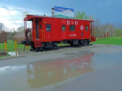 Reflections After The Storm (Trains & Trails) Tags: caboose railcar restored vintage history bo baltimoreandohio connellsville pennsylvania fayettecounty display tourism gap greatalleghenypassage c2891 railroad puddle water reflection red