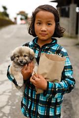 Shopping with my Dog (._-Patrick-_.) Tags: india tawang northeast northeastindia arunachalpradesh arunachal pradesh canon 5diii 2470 people portrait dog shopping girl puppy young