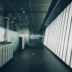 Lightbox (Olly Denton) Tags: corridor lights lockers wall lighting glass metal vanishingpoints perspective dots architecture architecturalphotographyarchitecturelovers iphone iphone6 6 vsco vscocam vscotoyko vscojapan tokyointernationalforum 東京国際フォーラム tokyo 東京 japan 日本