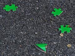 1 Finds Pieces of the Puzzle (Robert Cowlishaw-Mertonian) Tags: mertonian robertcowlishaw puzzle pieces green canon powershot sx60hs canonpowershotsx60hs lookingdown pavement curious lookingforward change melancholy blues decisions texture damaged acedia