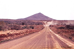 Main Road to Ethiopia, 1980, Northern Kenya Image0193 (Hart Walter) Tags: tourism coffee cattle rice tea goats sunflower sisal camels sugarcane deforestation desertification tef africanlanduse baobabdestruction