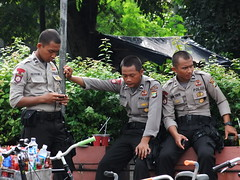 Three polices and their stories (yusuf ks) Tags: indonesia candid police jakarta polisi sooc