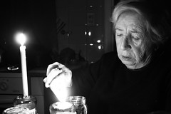 (Nowhere land ) Tags: grandma light blackandwhite bw woman blancoynegro face candles darkness grandmother cara bn abuela oldwoman wrinkles velas oscuridad seora arrugas encender