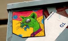 Zombie Cat (See El Photo) Tags: street city urban 15fav favorite streetart color colour art monster ink cat canon outside outdoors eos rebel sticker stickerart kat colorful colore bright drawing zombie vibrant vivid whiskers urbanart 100views mean fav draw mad creature grumpy loud couleur snarl foaming aufkleber faved adesivo etichetta étiquette ステッカー 111v1f 贴纸 наклейка αυτοκόλλητηετικέτα