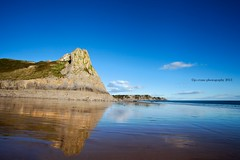 Reflection of Great Tor (Jo Evans1 - Off and on for a while) Tags: blue autumn light wet swansea reflections bay three sand skies very cliffs gower