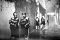 First rains of the year (N A Y E E M) Tags: street school girls rain uniform afternoon candid monsoon windshield neighbours yesterday bangladesh chittagong rabiarahmanlane