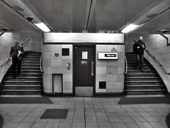 Two Steps Ahead (IngeniousImages) Tags: city uk 2 two england people urban bw london monochrome stairs underground subway mono metro britain tube steps symmetry gb aldgate urbex aldgatelondonundergroundstation