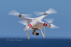 Age of the Drones (Malcom Lang) Tags: drone four blades camera blue photography red white sky sea mal lang canoneos6d canon canon6d canonef canon100400 100400mm canon100400ef canonef100400 outdoor outside outdoors