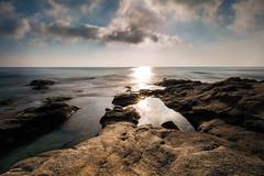 Cote sauvage V (electron2009) Tags: mer ocean poselongue méditerranée nuage ciel cloud sun soleil rocher rock bleu canon