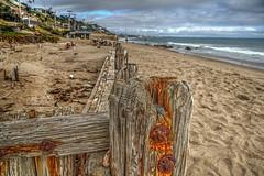 Rotting Pilings on the sand (Michael F. Nyiri) Tags: malibu california southerncalifornia beach ocean