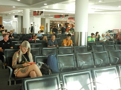 Waiting (sander_sloots) Tags: perth domestic airport waiting tattoos people lady tattooed tatoeages vrouw girl candid glasses