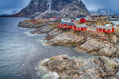 Travel Concepts and Ideas. Classic Traditional Norwegian Fishing Hut Called Hamnoy in Norway. (DmitryMorgan) Tags: norway norwegian panorama scandinavia arctic bay coast environment europe fjord hamnoy harbor house hut isle light lofoten lofotenislands mountains nature nopeople noone ocean outdoor picturesque polarcircle red reddish reine reinefjord scenery scenic seascape snowy traditional traveldestination travelling village water
