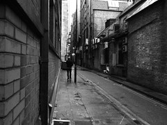 a call he couldn't miss (vfrgk) Tags: alley backalley urbanphotography urbanfragment urbanlife urban citylife cityview architecture man people monochrome blackandwhite bw perspective pov gritty gloomy