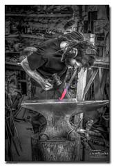 On The Anvil (jeremy willcocks) Tags: anvil blacksmith working hot heat red blackandwhite allerford somerset uk england person making hammer jeremywillcocks wwwsouthwestscenesmeuk mono fujixpro2 xf50140mm