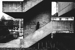 queen of the underworld (matthias hämmerly) Tags: zürich zuerich switzerland candid street streetphotography sun shadow contrast grain ricoh gr black white bw monochrom monochrome city town urban einfarbig stair stairs silhouette