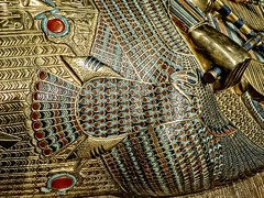 Closeup of the uraeus on the body of King Tutankhamun's first inner coffin New Kingdom 18th Dynasty Egypt 1332-1323 BCE (mharrsch) Tags: uraeus gravegoods gold pharaoh king ruler coffin tutankhamun burial tomb funerary 18thdynasty newkingdom egypt 14thcenturybce ancient discoveryofkingtut exhibit newyork mharrsch premierexhibits