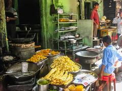 _IMG_10113 (Manveer Jarosz) Tags: bharat hindustan india nathdwara rajasthan building chaat child food green kitchen market mithai outdoors people pilgrimage sitting street streetfood sweets tawa wall