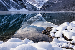 Snow-Framed Reflections (Kristin Repsher) Tags: alberta banff banffnationalpark canada canadianrockies d750 freezing lakelouise nationalpark nikon rockies rockymountains snow stream winter