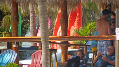Enjoying the the Waterside (soniaadammurray - On & Off) Tags: digitalphotography restaurant people cocktails kayaks paddleboards trees chairs colours macro macromondays