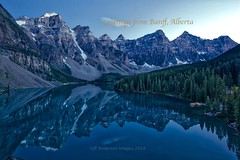 Greetings from Banff Alberta (John Andersen (JPAndersen images)) Tags: alberta banff calm girls lake lakemoraine log mountains portrait postcard