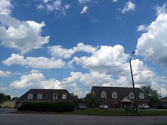 Buildings At Walnut Manor Apartments. (dccradio) Tags: lumberton nc northcarolina robesoncounty outside outdoors sky clouds bluesky tree trees greenery apartmentbuilding streetlight architecture pavement