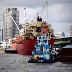 Port of NOLA (StephenReed) Tags: portofnola cargoship tugboat mississippiriver skyscraper neworleans louisiana square nikond3300 stephenreed barge