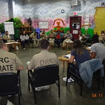 Students and inmates at a local prison sitting down having a discussion
