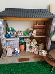 Garden shed (moonpiedumplin) Tags: plant dirt garden shed pot flower mcdonalds bar yard food fun fixin treasures pretty nook island stools fashion curio cabinet 80s ooak cottage frame yellow diorama scale 16 grill redo pool vintage furniture mattel deluxe custom repaint remake doll gloria kitchen mansion house dream barbie