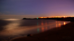 Green Light (Gareth83cdf) Tags: uk longexposure light sunset sea lighthouse inspiration reflection art beach wales night landscape sand nikon rocks experimental view horizon creative shore barry mysterious magichour valeofglamorgan barryisland barrydocks d5100 thebendricks
