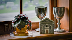 Around the Church: Potted Plant and Chalices (Entropic Remnants) Tags: pictures life old church photography photo still image photos pics colonial picture pic images panasonic photographs photograph f28 remnants entropic gx1 1235mm dmcgx1