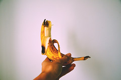 Untitled (Joshua Lam Photography) Tags: food white house canada colour home me yellow fruit vancouver yummy healthy holding hands mine hand bc yum eating finger fingers eaten banana eat colourful hold abode nutrients