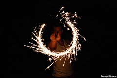 Peti (somogyibarbara) Tags: light boy summer lightpainting man black guy face night contrast dark painting circle point fire evening interesting friend darkness arm magic peter teen midnight pete mate sparkler pointing spark tee magician chap