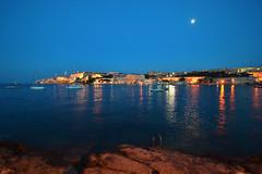 Moon over Valletta (albireo 2006) Tags: blue sea moon water night reflections coast mediterranean malta clear valletta floriana taxbiex