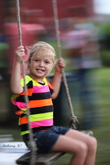 Excitement blur (AnthonyGR) Tags: family party summer girl fun happy joy happiness swing motionblur brightcolors swinging 2013 subjectseparation