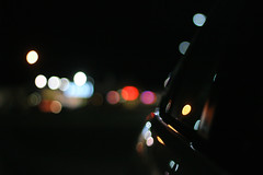 Noise (lainey koch) Tags: city color reflection window colors car night canon lights drive blurry driving bokeh creative sharp polkadots nighttime citylights softfocus nightsky dots carwindow sharpness warmcolors canonphotography canonrebelxti