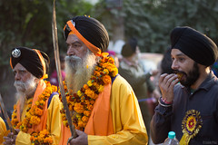 Gurunanak Jayanti (ashok.pillai) Tags: street flowers food india photography eating delhi organizer sword sikh punjabi saffron turbans sardar headgear pyare panch