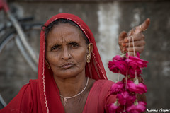 Red is the color (karmajigme) Tags: lady woman human rajasthan india red flowers travel streetphotography nikon
