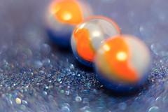 Halo (L E Dye) Tags: macromonday orangeblue alberta canada d5100 ledye marbles nikon 68mmextensiontubes