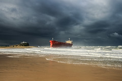 Shipwrecked Supertanker (robertdownie) Tags: sea water beach clouds coast rocks ship seascape australia shipwreck new south wales nsw wreck newcastle pasha beached nobbys bulka supertanker