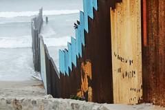Border Wall (AndyM.) Tags: canon eos xsi 55250mm tijuana mexico borderwall beach blue