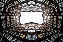 Up is out (Maerten Prins) Tags: germany duitsland deutschland hamburg hof court mirrorandcopy symmetry composition upshot architecture sky