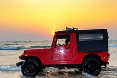 Nothing beats a good drive like this... (Sudhakar Madala) Tags: sea waves jeep arabiansea sunsetbeach sunset sunsetphoto orangesky orange red vehicle evening sun drive ride nature april photographer photography canon eos amazing beautiful colorful colourful driver tyres black