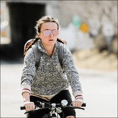 Bicycle Girl on Bank Street April 9 2017 (Dan Dewan) Tags: dandewan bicycle canon7dmarkii street canon canonef7020014lusm cyclist 2017 sunday girl ottawa woman portrait ontario bankstreet glasses sunglasses lady april