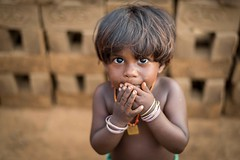 Innocence (Logesh Photostream) Tags: childinnocencethirimazhisainikonindia brick labour child eyes portrait hardlife nikon d750 50mm 18g street streetlife