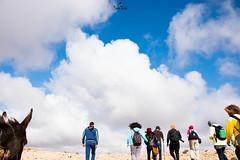 The sky is the limit .. go there (sanaturki) Tags: sky clouds blue people walk donkey tunisia nikon d5300