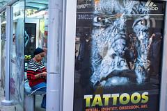 Obsession (klauslang99) Tags: street photography klaus lang toronto advertisement person tattoos