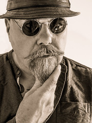 Hipster selfie. (CWhatPhotos) Tags: cwhatphotos olympus four thirds camera photographs photograph pics pictures pic picture image images foto fotos photography artistic that have which contain me self selfie portrait face jumper beard bush bushy full hairy chin goatee sepia black white mono mugshot man male leather pork pie hat head wear pointy round shades sunglasses sun glasses hipsterman hipster pose smoothy smooth