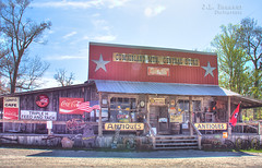 Cumberland Mountain General Store - Clarkrange, Tennessee 1 (J.L. Ramsaur Photography) Tags: jlrphotography nikond7200 nikon d7200 photography photo clarkrangetn middletennessee fentresscounty tennessee 2017 engineerswithcameras cumberlandplateau photographyforgod thesouth southernphotography screamofthephotographer ibeauty jlramsaurphotography photograph pic clarkrange tennesseephotographer clarkrangetennessee sign signage it'sasign signssigns iloveoldsigns oldsignage vintagesign retrosign oldsign vintagesignage retrosignage faded fadedsignage fadedsign iseeasign signcity rural ruralamerica ruraltennessee ruralview oldbuildings structuresofthesouth smalltownamerica americana patrioticproud patriotic americanflag usflag redwhiteblue starsandstripes oldglory cumberlandmountaingeneralstore generalstore cumberlandmountainstore cocacola cokesign cocacolasign coke cocacolabottlingworks cocacolascript antiques tennesseestateflag tennesseeflag